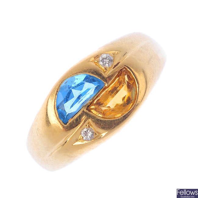 An 18ct gold citrine, topaz and diamond dress ring.