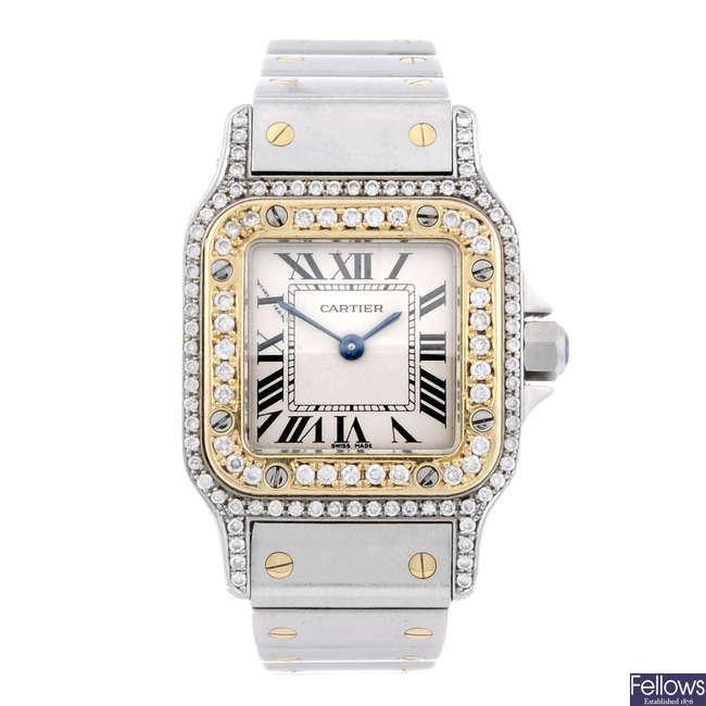 CARTIER - a diamond set bi-metal Santos bracelet watch.