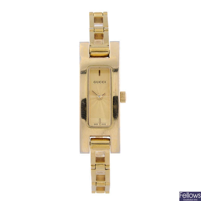 GUCCI - a lady's gold plated 3900L bracelet watch with a lady's Tissot watch.