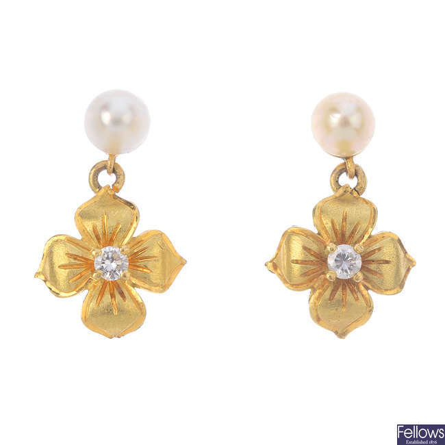 A pair of cultured pearl and diamond floral earrings.