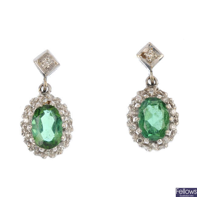 A pair of tourmaline and diamond cluster earrings.