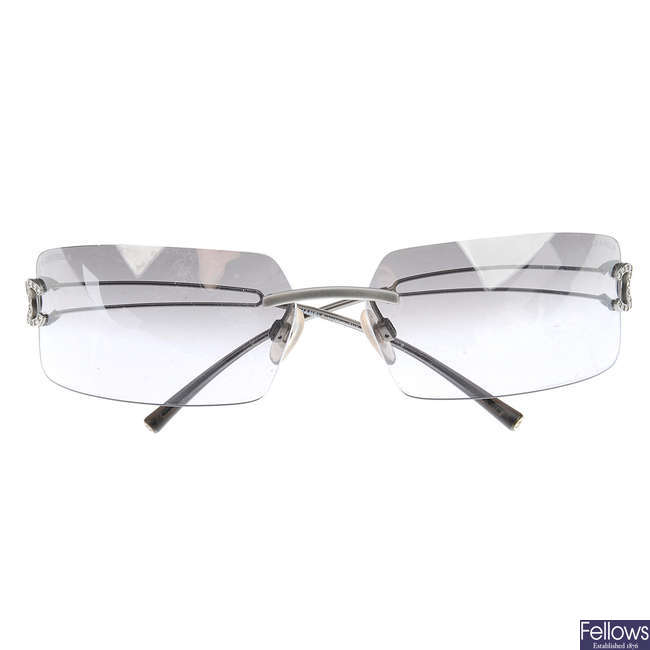 CHANEL - a pair of rimless sunglasses.