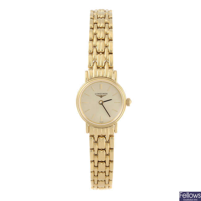 LONGINES - a lady's gold plated Presence bracelet watch with a Gucci watch.