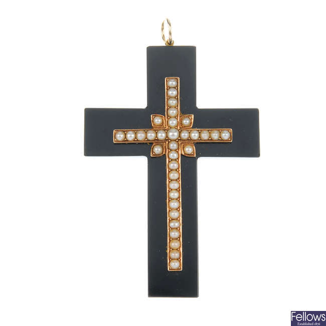 A late Victorian onyx and seed pearl cross pendant.