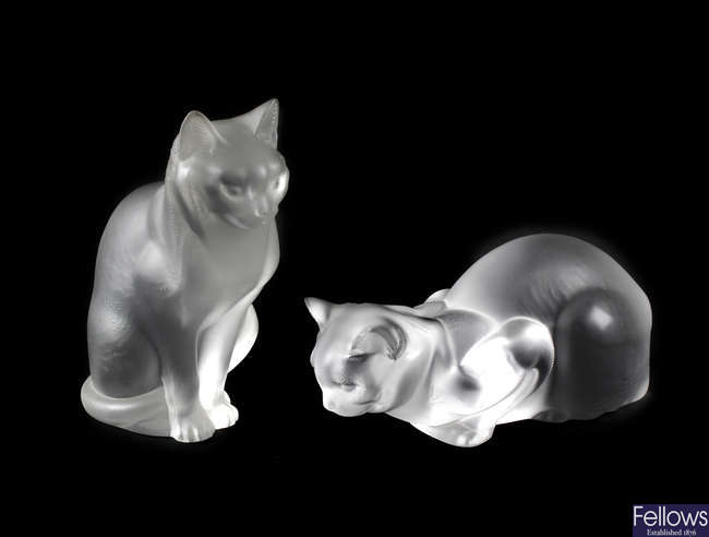 A pair of large Lalique glass cats