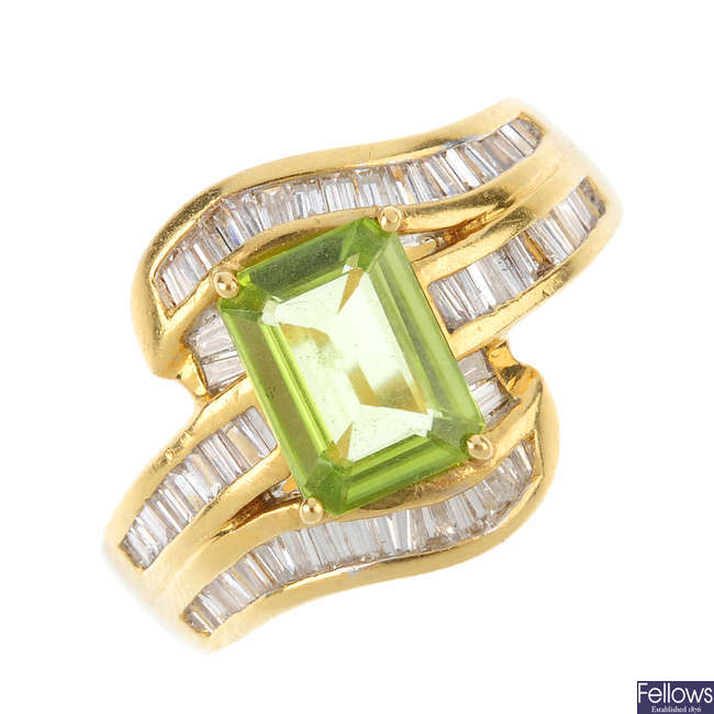A peridot and diamond dress ring.