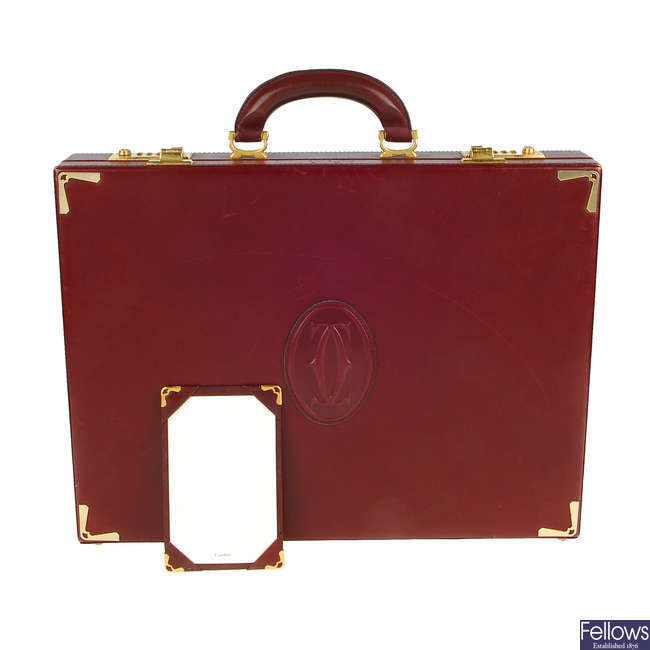CARTIER - a 1980s Must De Cartier Bordeaux briefcase with writing pad and paper.