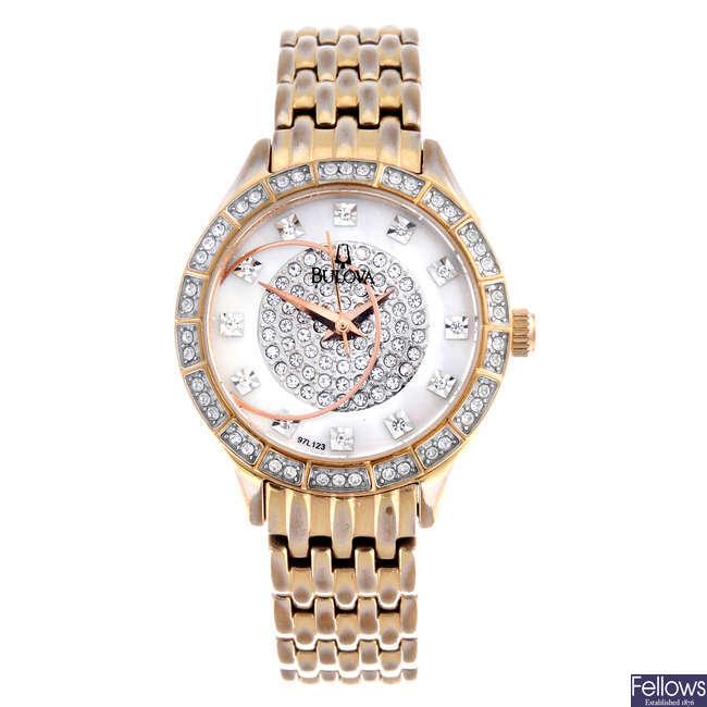 BULOVA - a lady's gold plated bracelet watch.