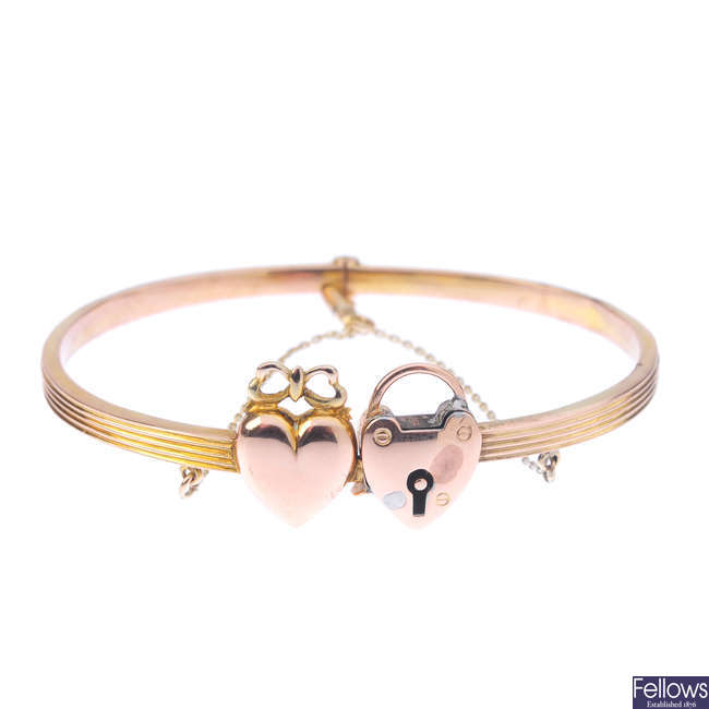 A late Victorian 9ct gold twin hearts bangle.