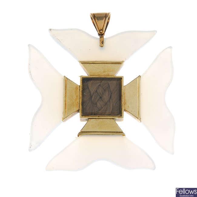 A late 19th century chalcedony memorial Maltese gold cross pendant.