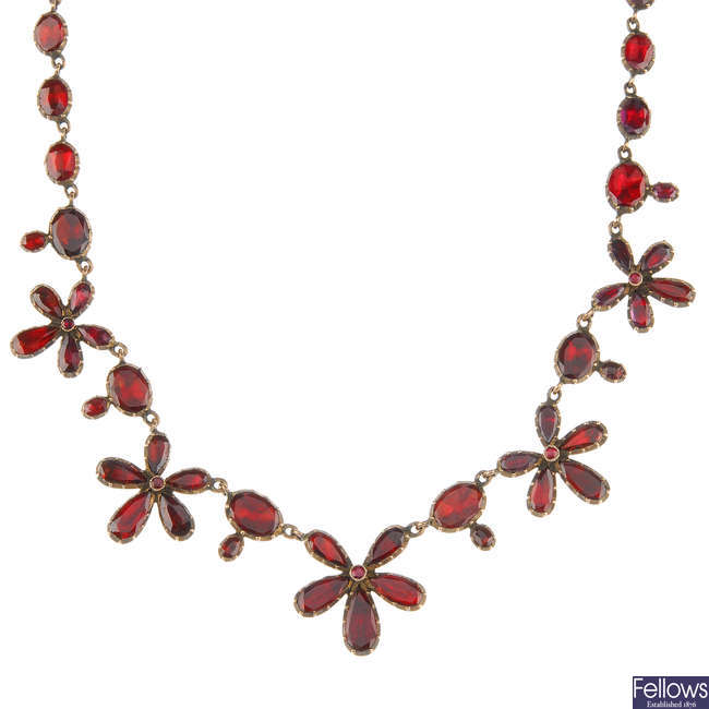 An early Victorian 9ct gold foil-back garnet necklace.