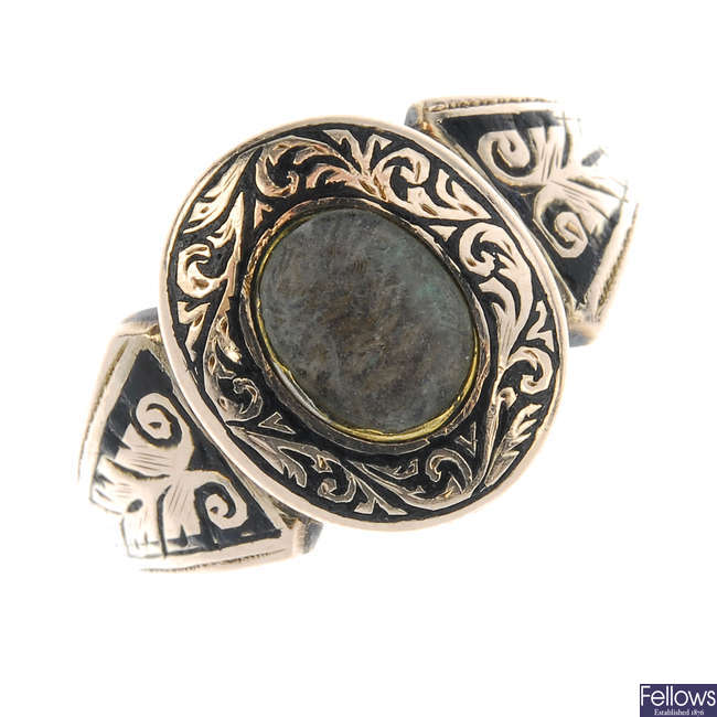 A late Victorian memorial woven hair and black enamel ring.