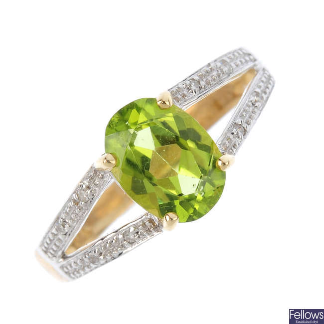 A 9ct gold peridot and diamond ring.