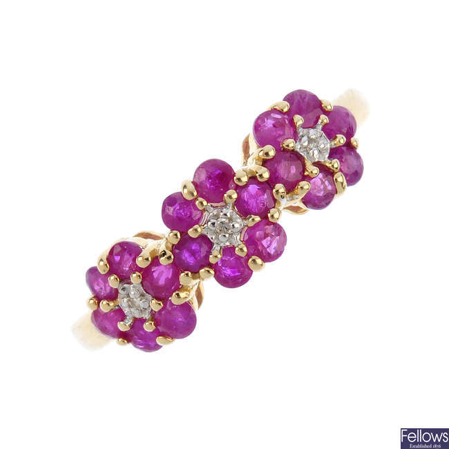 A 9ct gold ruby and diamond triple cluster ring.