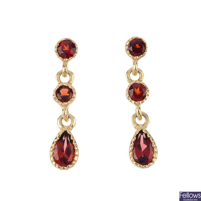 A pair of garnet earrings.