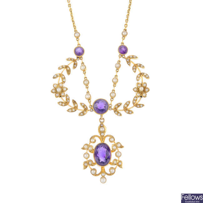 An Edwardian 15ct gold amethyst and split pearl necklace.