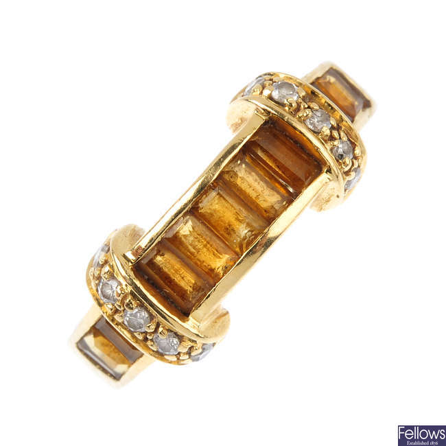 An 18ct gold citrine and diamond ring.