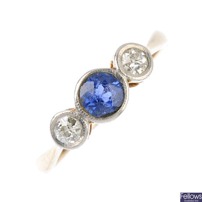 An early 20th century gold sapphire and diamond three-stone ring.