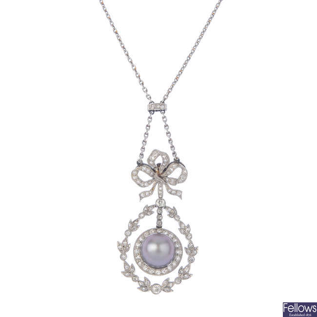 An Edwardian platinum, cultured pearl and diamond pendant, with fitted Koch case.