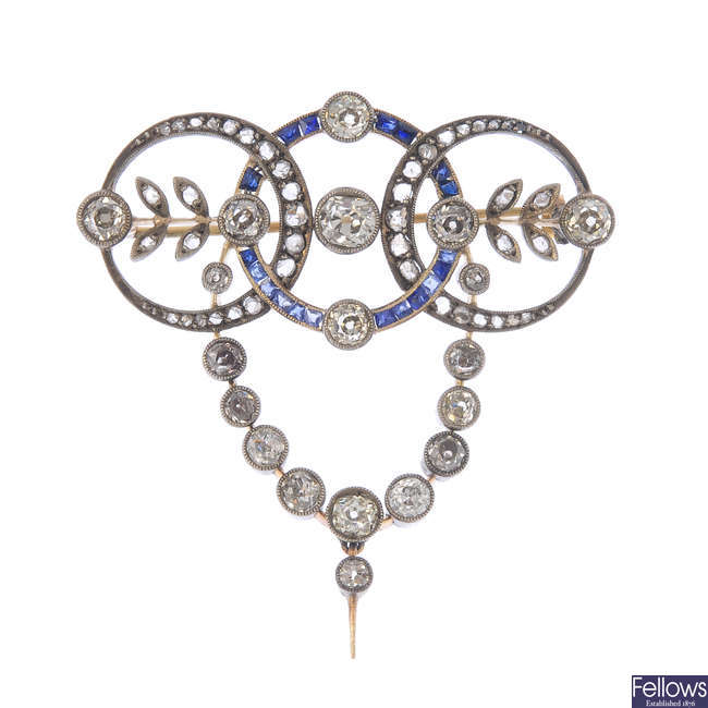 An early 20th century diamond and sapphire brooch, with chain.