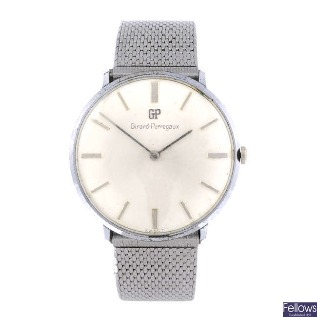 GIRARD-PERREGAUX - a gentleman's stainless steel bracelet watch with two other gentleman's watches.