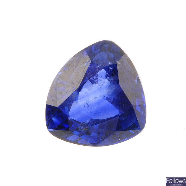 A triangular-shape sapphire, weighing 3cts.