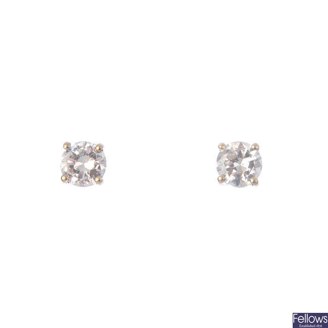 A pair of 18ct gold brilliant-cut diamond stud earrings.
