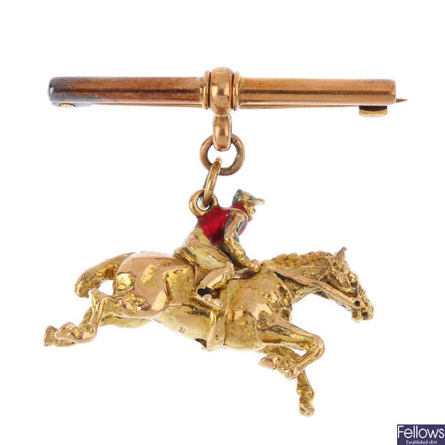 A 9ct gold horse and jockey brooch.