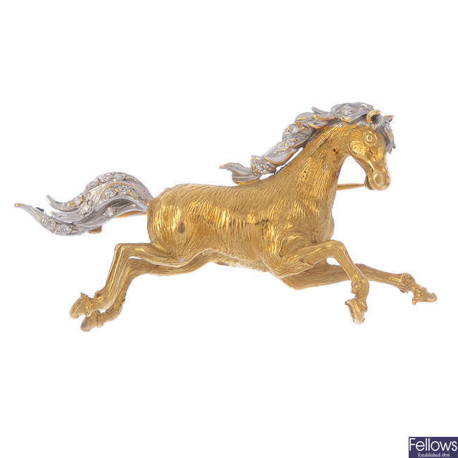 An 18ct gold diamond horse brooch.