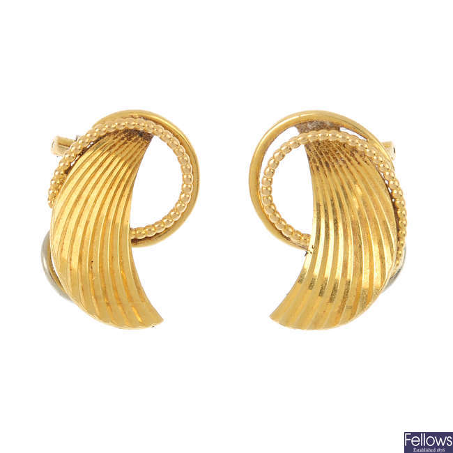 A pair of 1980s 18ct gold clip earrings.
