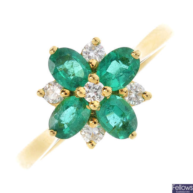 An 18ct gold emerald and diamond floral cluster ring.