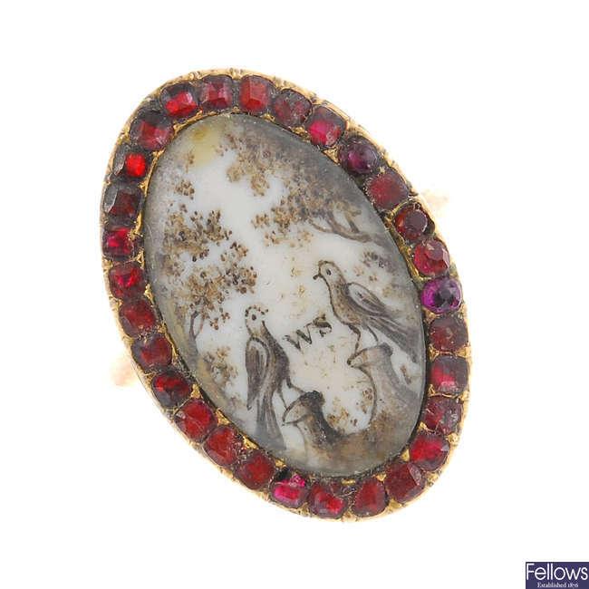 A late Georgian gold, sepia and garnet memorial ring.