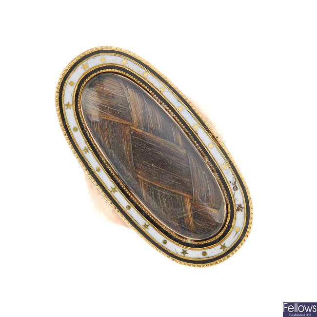 A late Georgian gold enamel memorial ring.