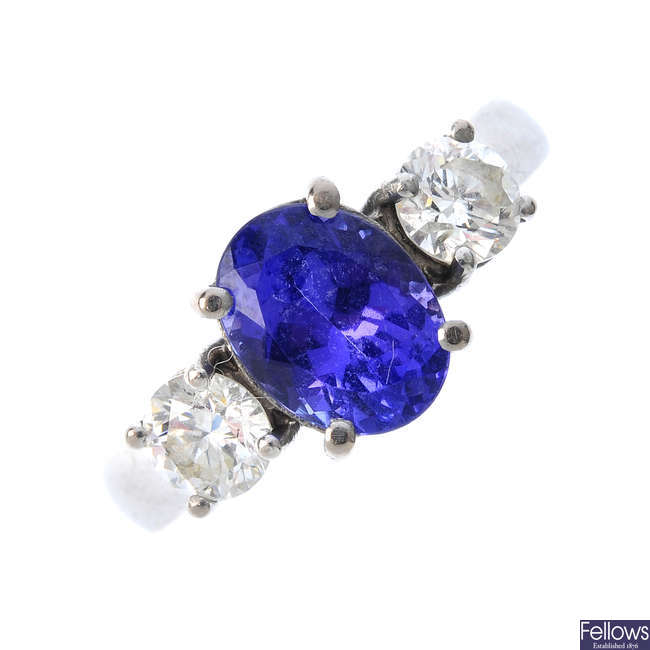 An 18ct gold tanzanite and diamond three-stone ring.