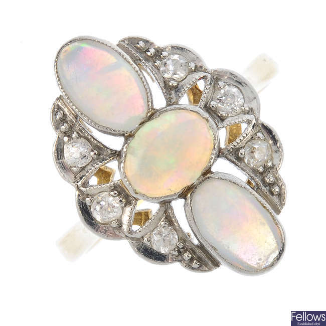 An opal and diamond dress ring.