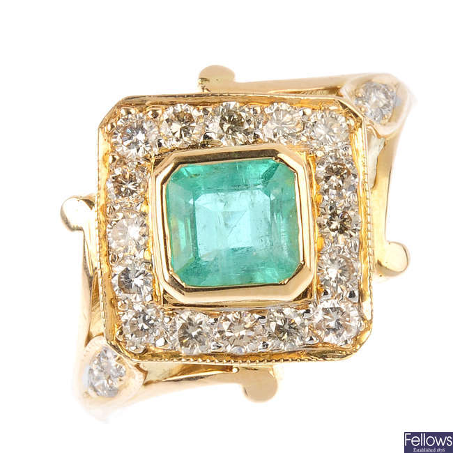 A 14ct gold emerald and diamond cluster ring.