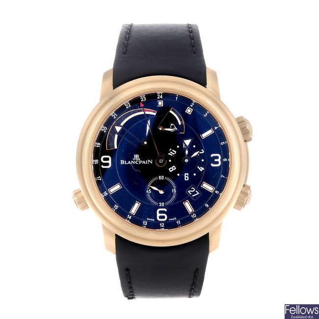 CURRENT MODEL: BLANCPAIN - a gentleman's 18ct rose gold Leman Réveil GMT wrist watch.