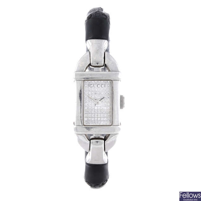 GUCCI - a lady's stainless steel 6800L bracelet watch with two other Gucci watches.