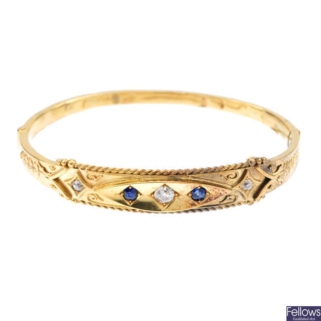 A late Victorian 15ct gold diamond and sapphire hinged bangle.