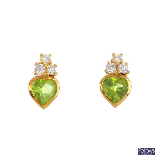 A pair of 18ct gold peridot and diamond stud earrings.