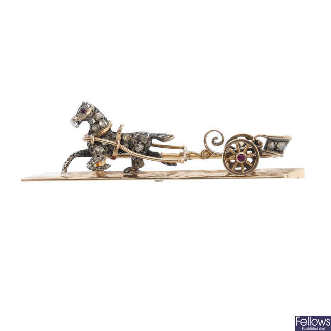 An early 20th century 15ct gold diamond horse and carriage brooch.