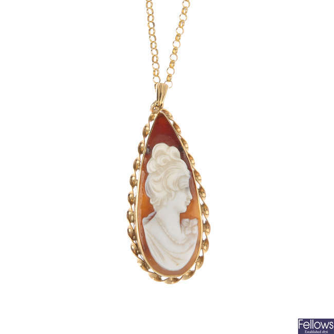 A 9ct gold shell cameo pendant and two 9ct gold rings.