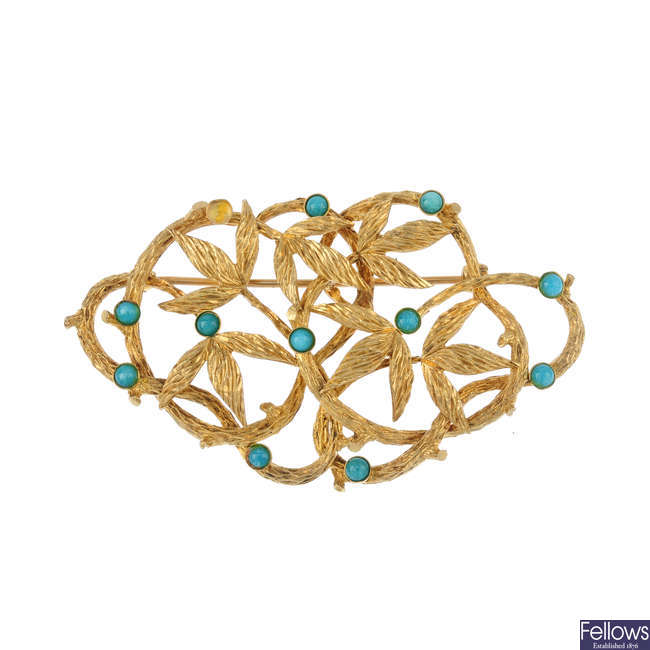 A 1960s 9ct gold reconstituted turquoise brooch.