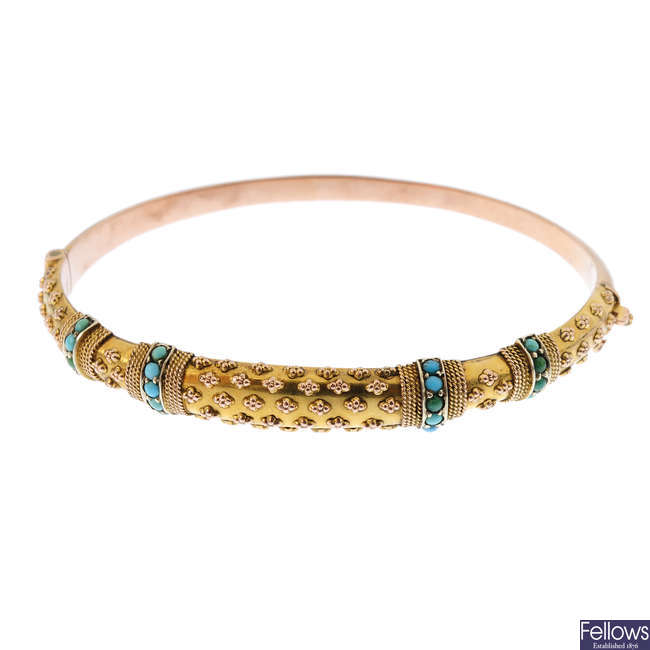 An Edwardian 9ct gold turquoise hinged bangle.