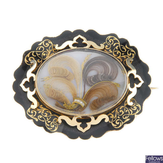 A late Victorian gold enamel memorial brooch.