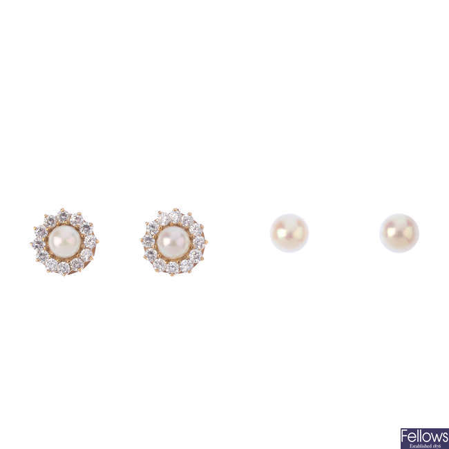 Two pairs of cultured pearl earrings.