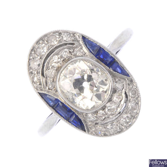 A diamond and sapphire dress ring.