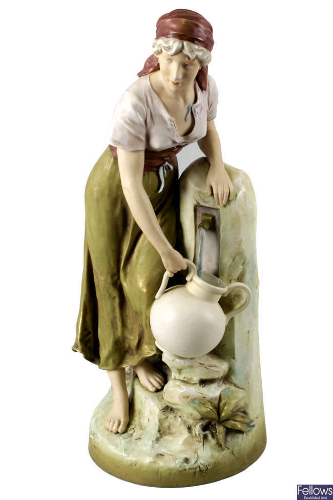 A large Royal Dux porcelain figure of a female water-carrier