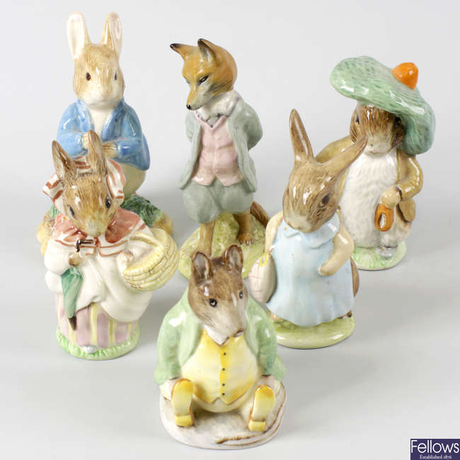 A large group of Beswick Beatrix Potter storybook figurines.
