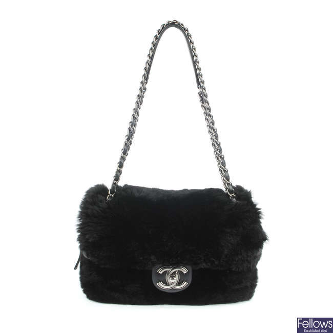 CHANEL - a Fur Flap handbag.